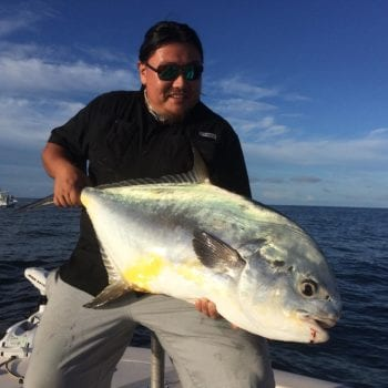 A fisherman who caught a permit with chasin tales charters on a southwest florida fishing charter.